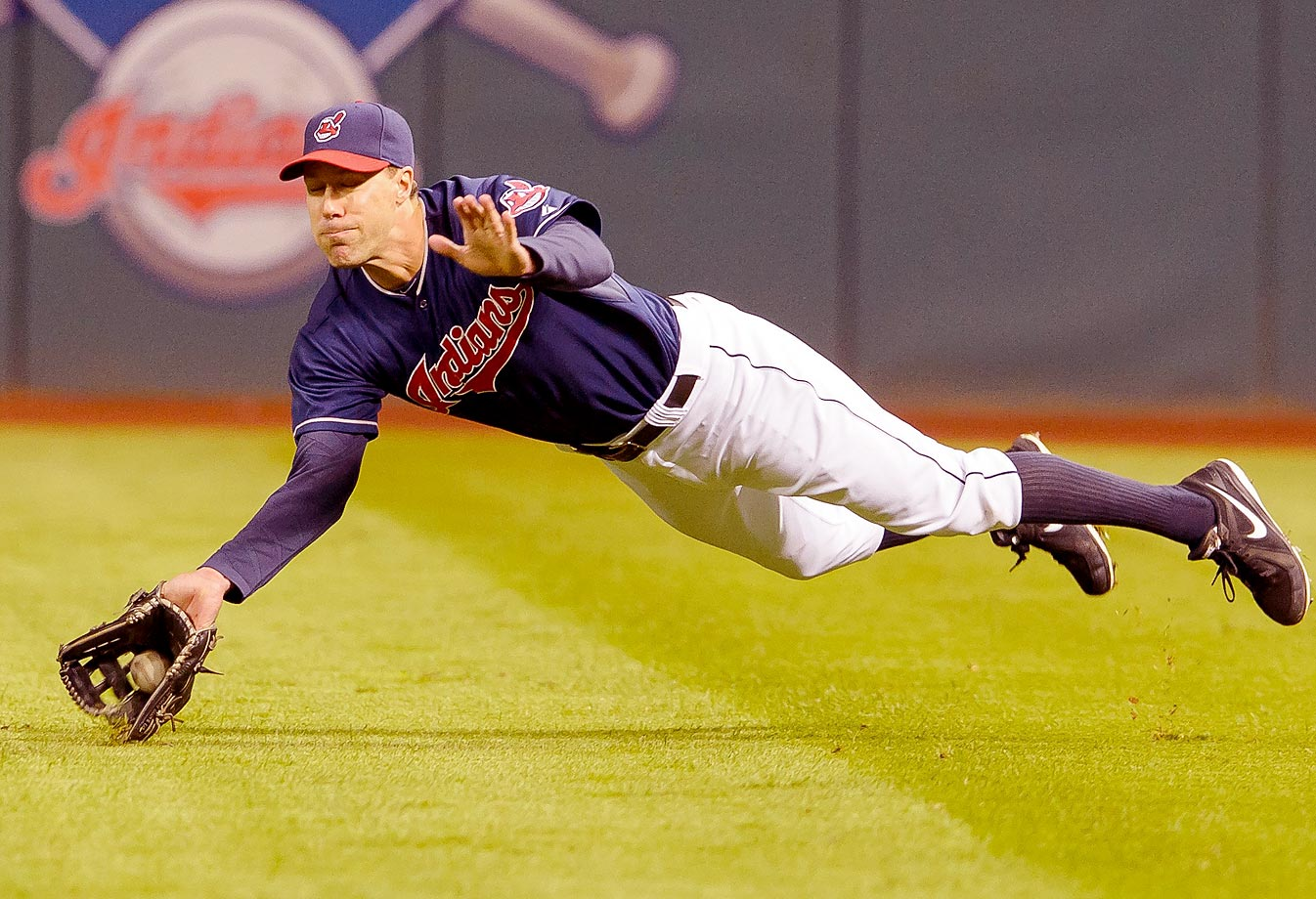 Cleveland Indians right fielder David Murphy makes a diving catch during the seventh inning against the Kansas City Royals. The Royals won the game 7-1.