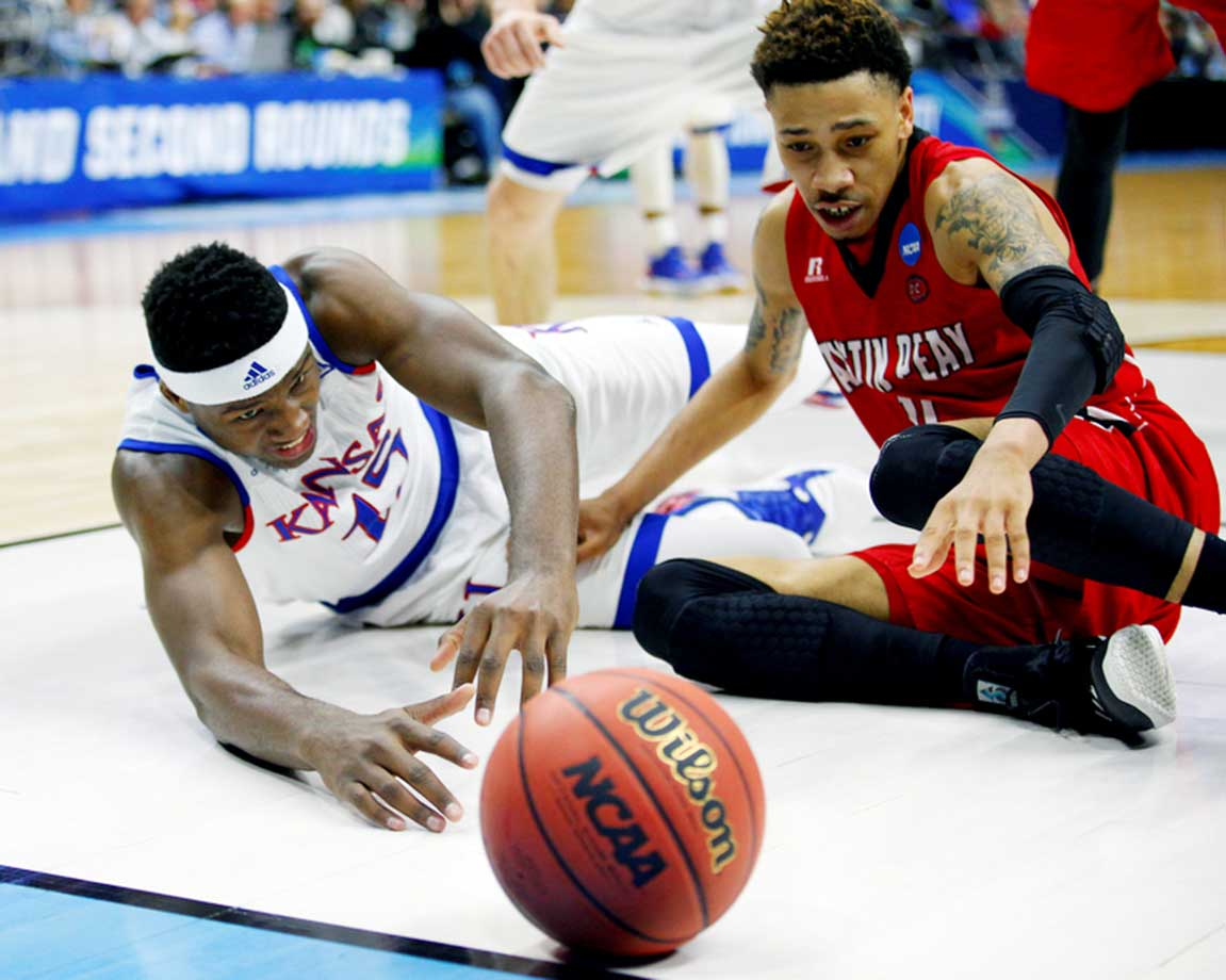 Carlton Bragg Jr. of Kansas and Khalil Davis of Austin Peay watch as a loose ball gets away from them.