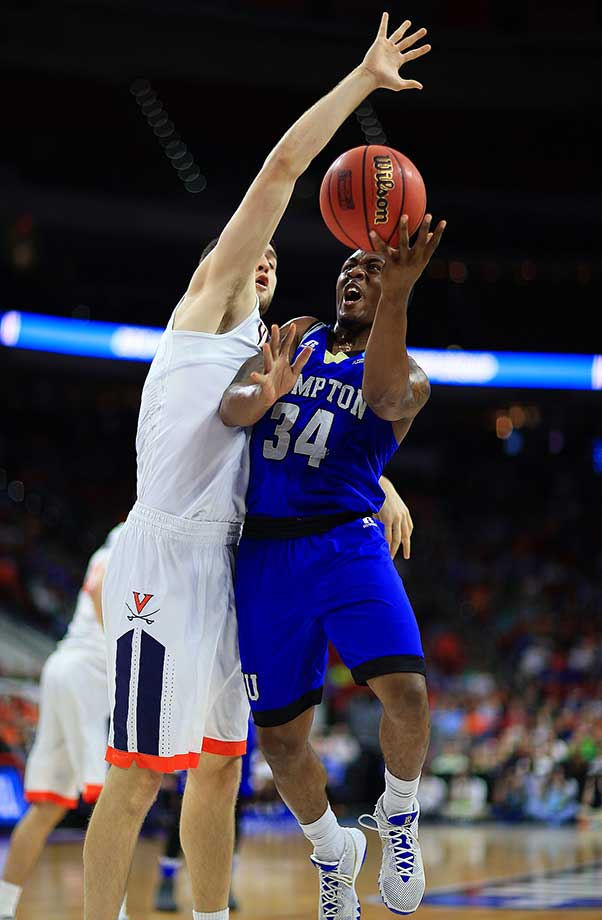 Reginald Johnson Jr. of the Hampton Pirates drives the lane against Virginia.