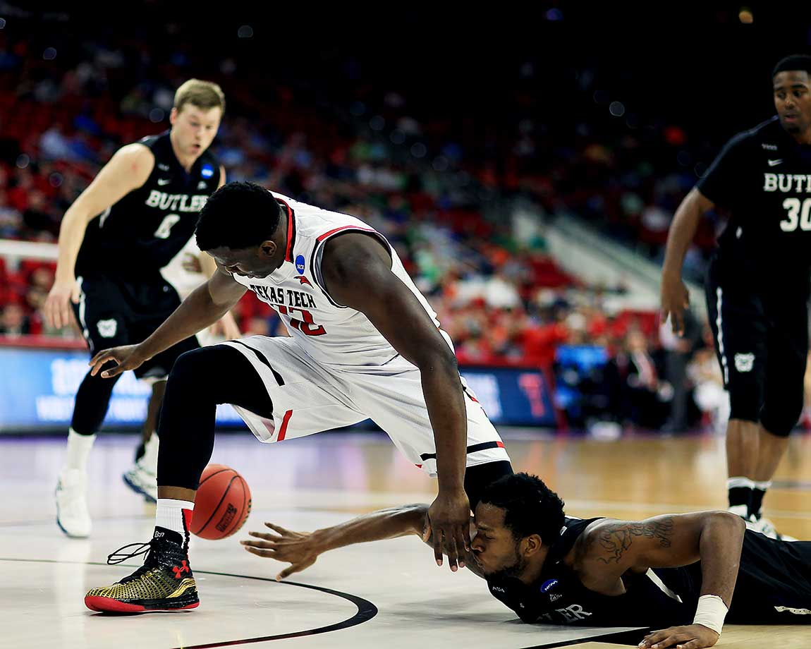 Butler's Tyler Wideman knocks the ball away from Norense Odiase of Texas Tech.