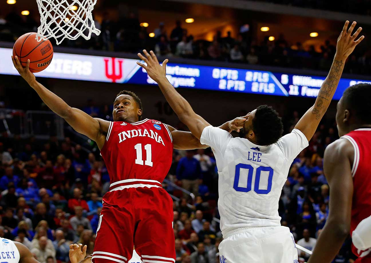 Yogi Ferrell of the Indiana Hoosiers shoots against Marcus Lee of Kentucky.