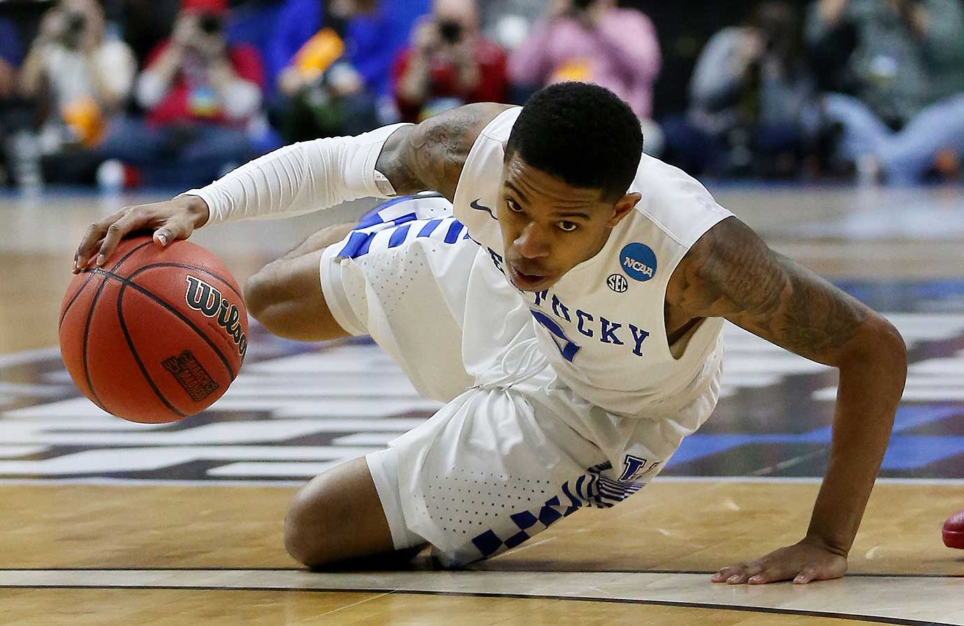 Tyler Ulis had a team-high 27 points for Kentucky, which suffered its earliest tournament exit since 2008.