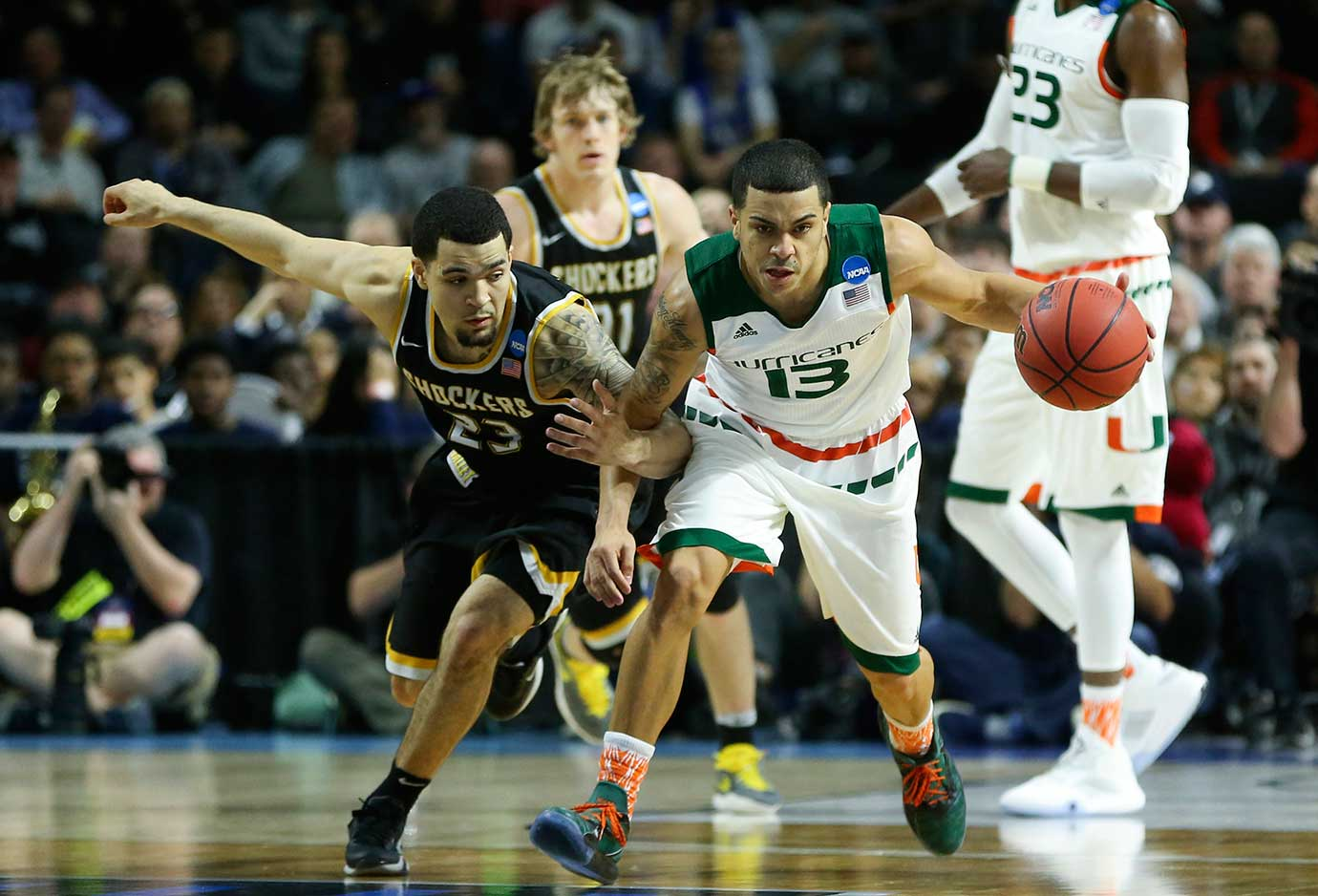 Wichita State's Fred VanVleet tries to steal the ball from Miami's Angel Rodriguez during the Hurricanes' 65-57 win.