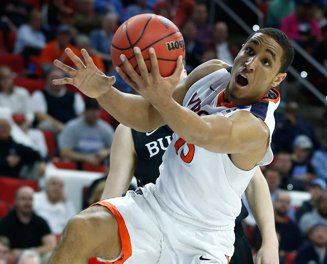 Malcolm Brogdon pulls in a rebound in front of Butler's Austin Etherington.