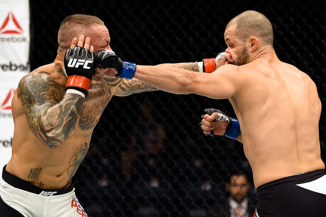 Ross Pearson of England punches Chad Laprise of Canada in their lightweight bout during the UFC Fight Night event in Brisbane, Australia.