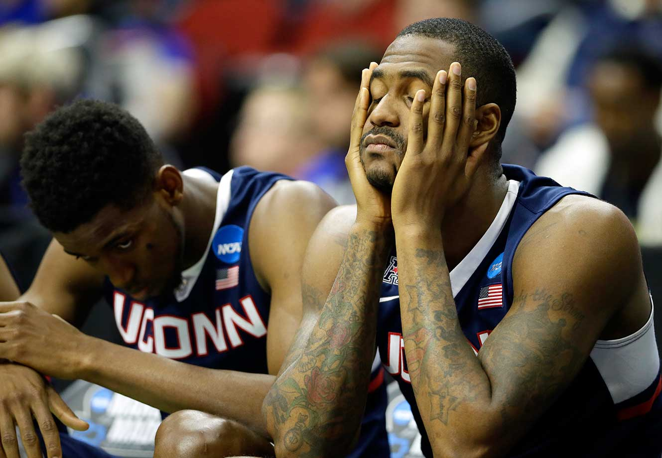 Connecticut's Phillip Nolan and Kentan Facey experience a little March sadness as the Huskies were ousted by Kansas.