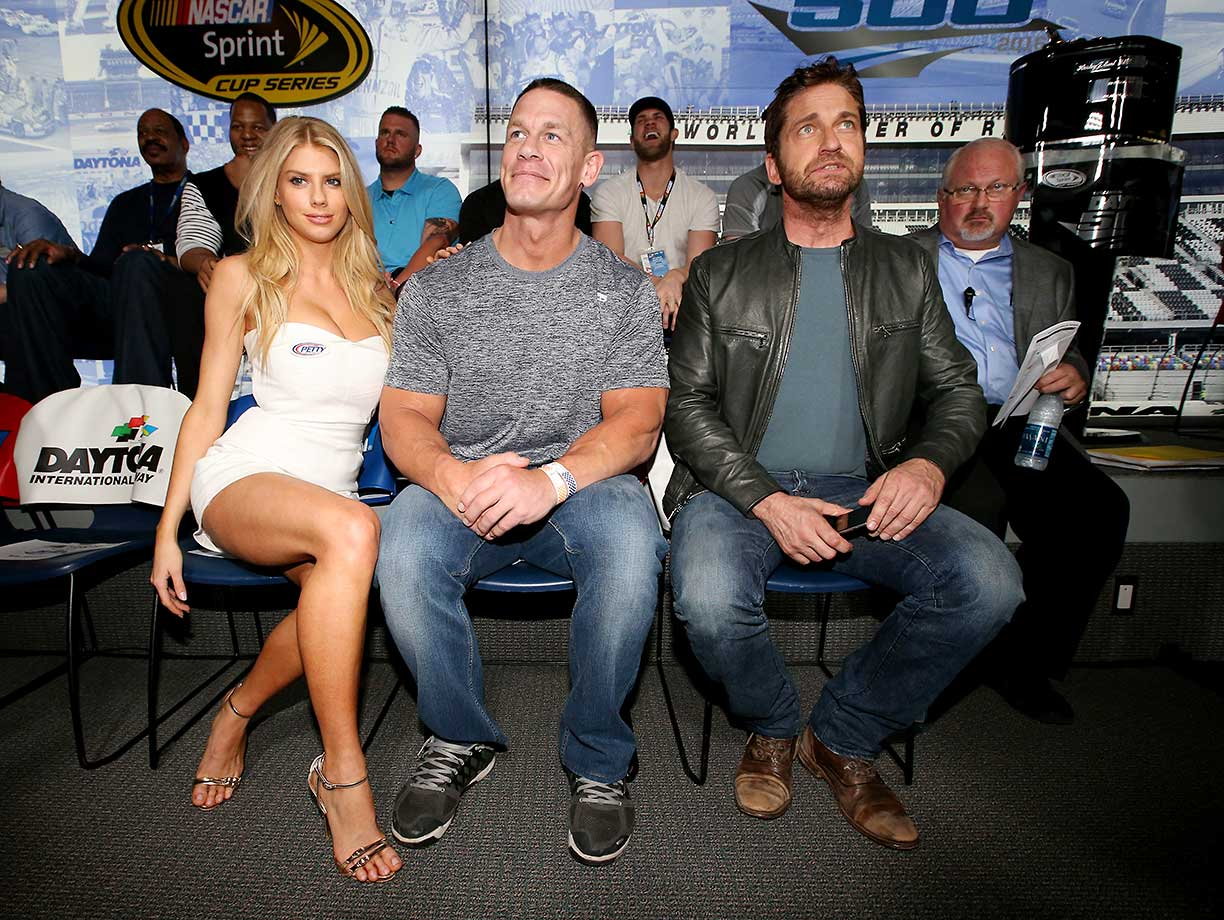 Charlotte McKinney, John Cena and Gerard Butler at the drivers's meeting before the start of Sunday's race.