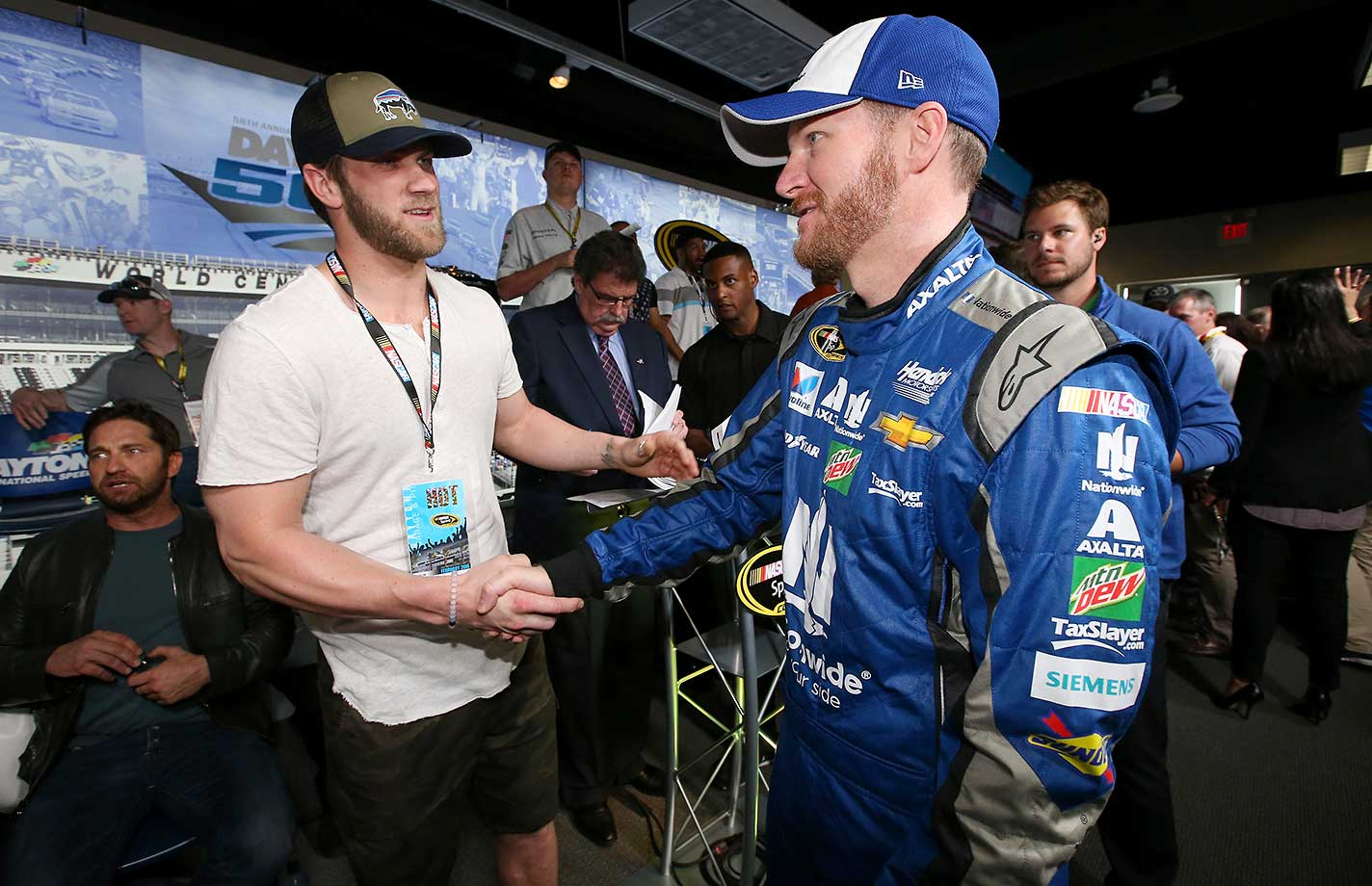 Bryce Harper talks to Dale Earnhardt Jr. at the drivers's meeting.