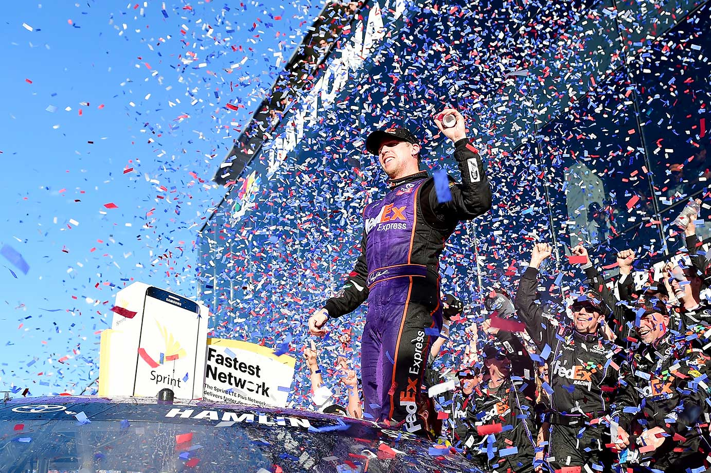 Denny Hamlin celebrates after winning his first Daytona 500, a race that had the closest finish in Daytona 500 history.