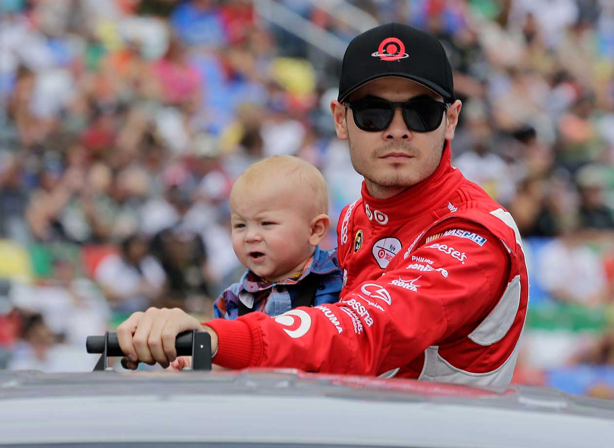 Kyle Larson, with his son, is introduced before the Daytona 500.