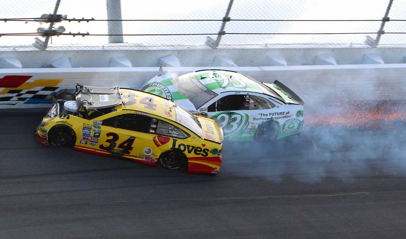 Chris Buescher (34) and Matt DiBenedetto crash during the Daytona 500.