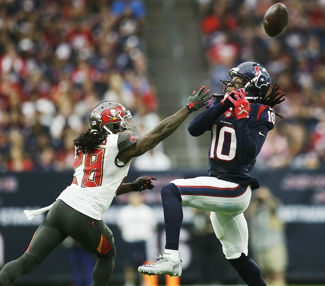DeAndre Hopkins misses a catch as Tampa Bay's Tim Jennings defends.