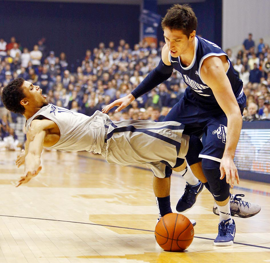 Xavier guard Dee Davis is fouled by Villanova guard Ryan Arcidiacono.