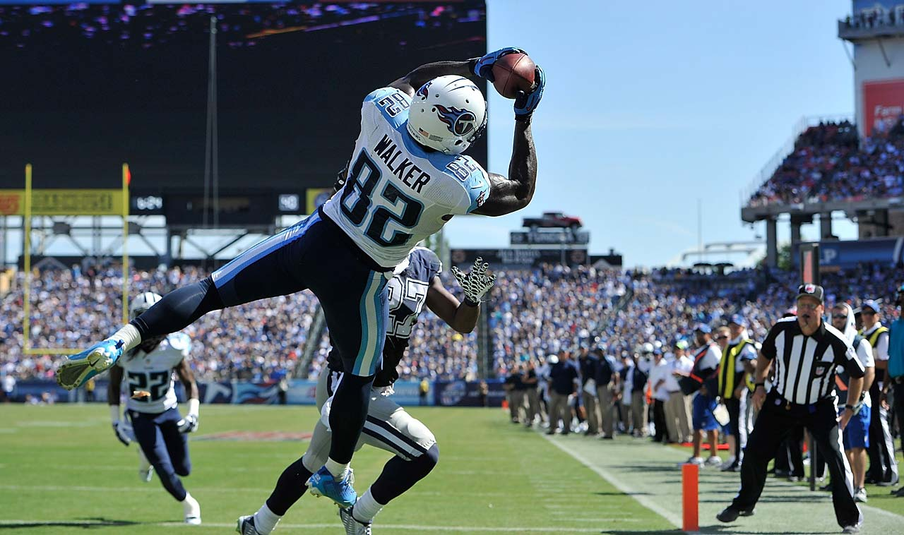 Delanie Walker of the Tennessee Titans catches the ball in the end zone moments before landing out of bounds for an incomplete pass against the Dallas Cowboys.