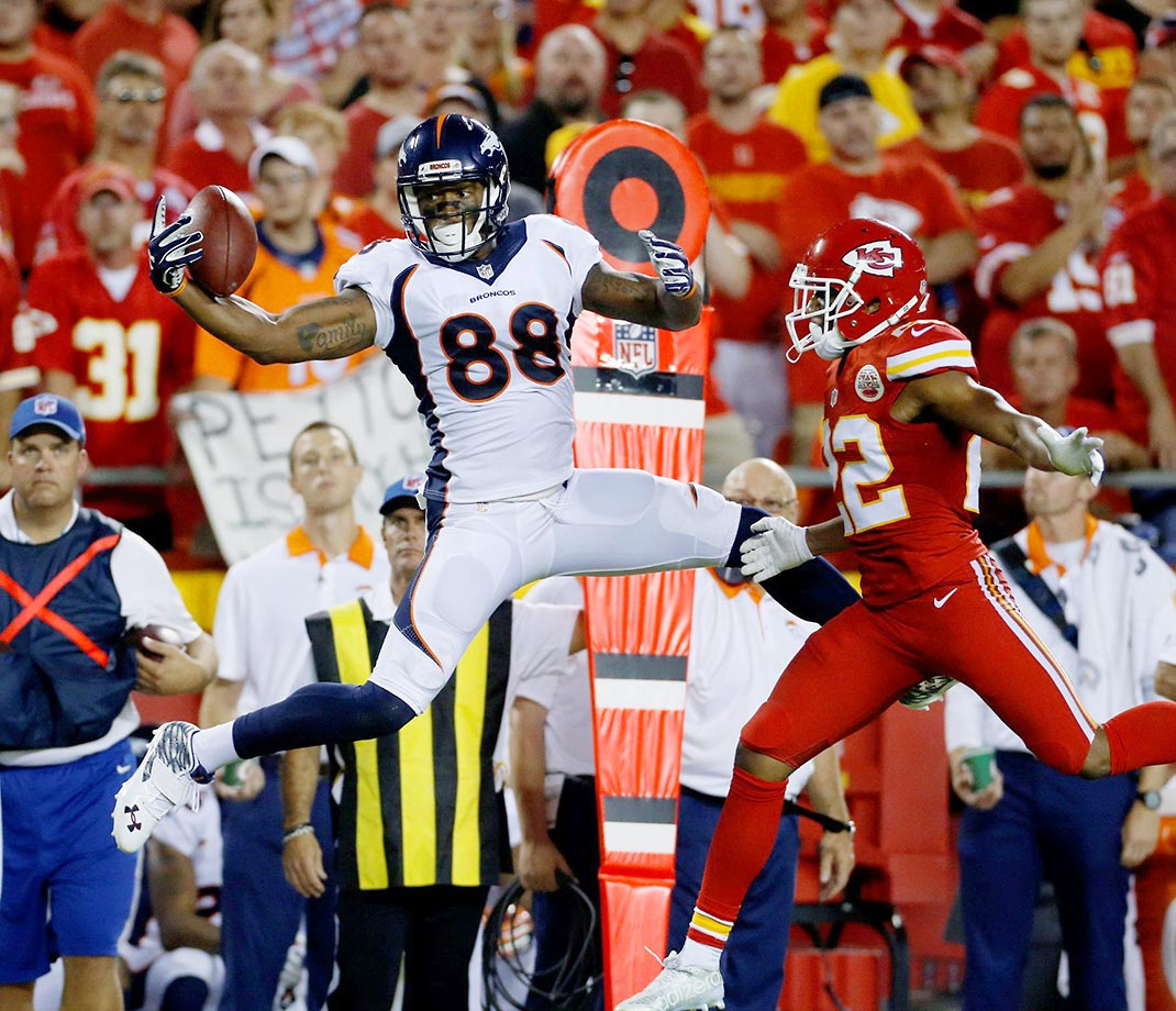 Demaryius Thomas goes up for a catch against Marcus Peters.