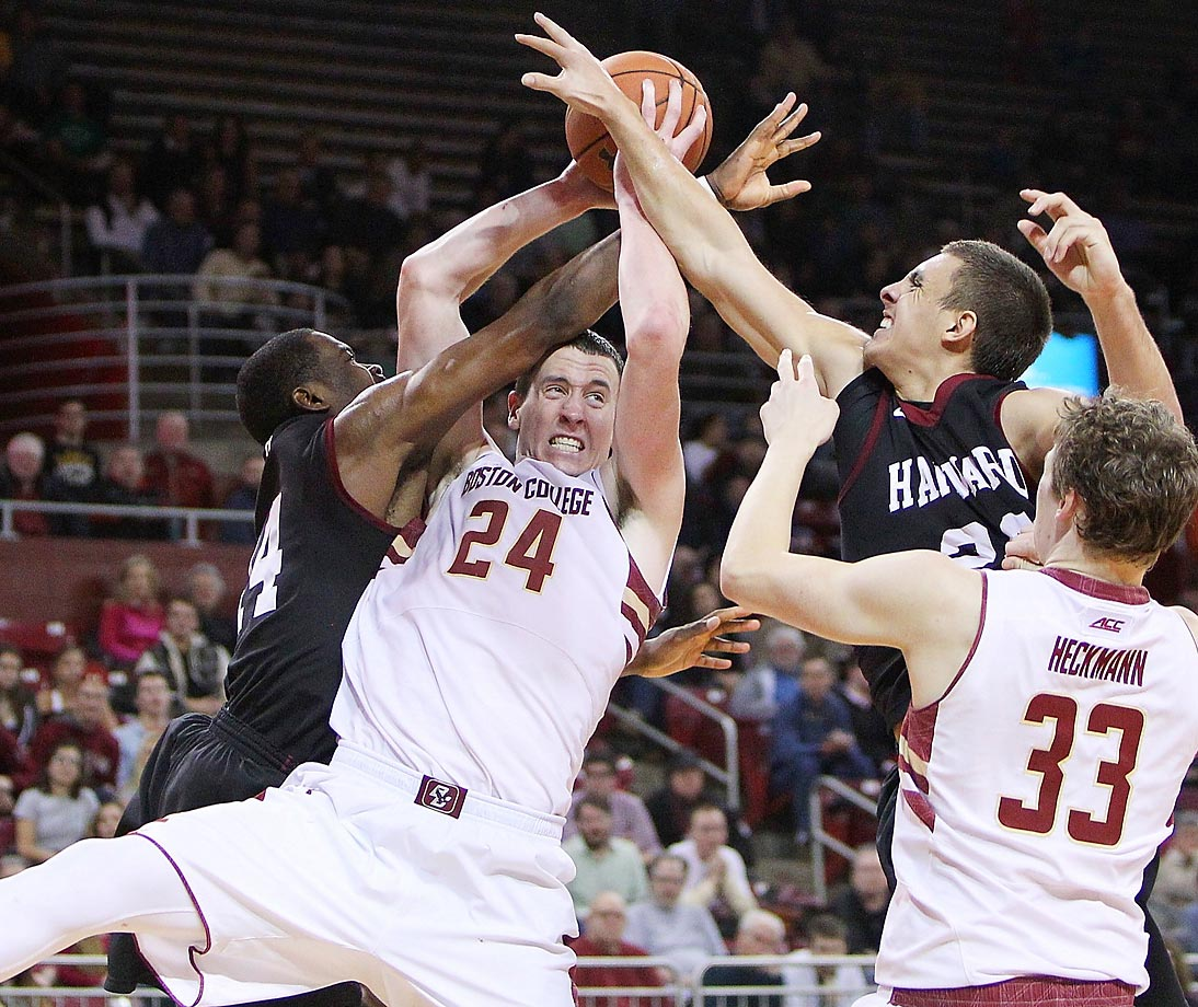 Dennis Clifford (24) and Patrick Heckmann of the Boston College Eagles reach for the ball against Steve Moundo-Missi (14) and Jonah Travis (24) of the Harvard Crimson in Chestnut Hill, Mass.