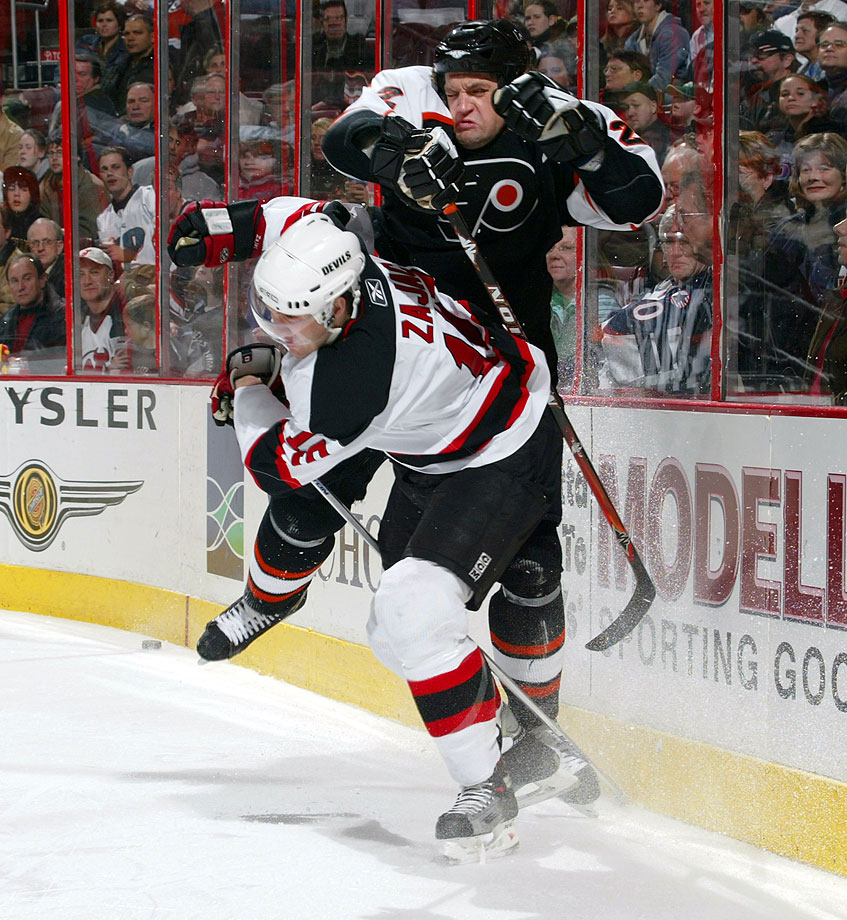 "Zajac's left middle finger was stitched and taped after New Jersey's contentious tilt against the Flyers on Jan. 4, 2008. Had the digit in question been Devils food for Flyers defenseman Derian Hatcher? That's what Zajac claimed. Hatcher scoffed, saying, ""If he's cut, good, but I didn't bite him."""
