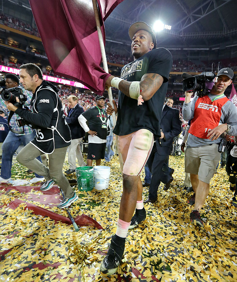 Derrick Henry celebrates shortly after he became the 17th player in history to win the Heisman Trophy and a national title in the same season.
