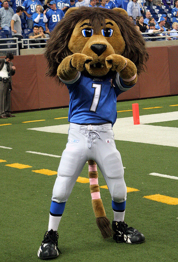 """He recently changed his appearance from the sleepy eyed lion with a """"Whaaaatever, dude"""" look to the glazed-eyed look you'd expect from the mascot of a team that hasn't gotten past the Wild Card round since 1991. His '80s hair does make us jealous, though."""