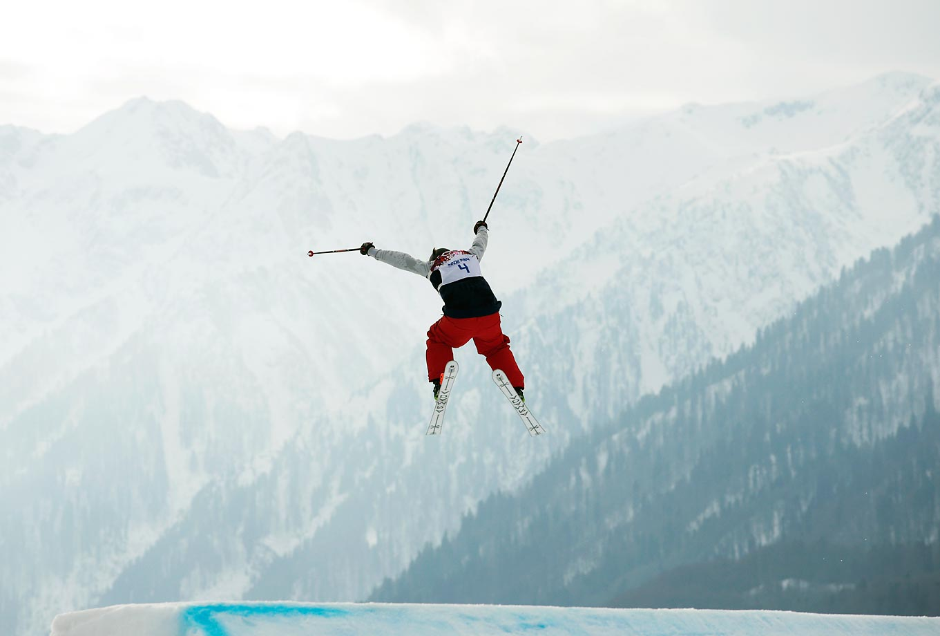 United States skier Devin Logan jumps during the women's freestyle skiing slopestyle qualifying at the Sochi Olympics. Logan won the silver medal.