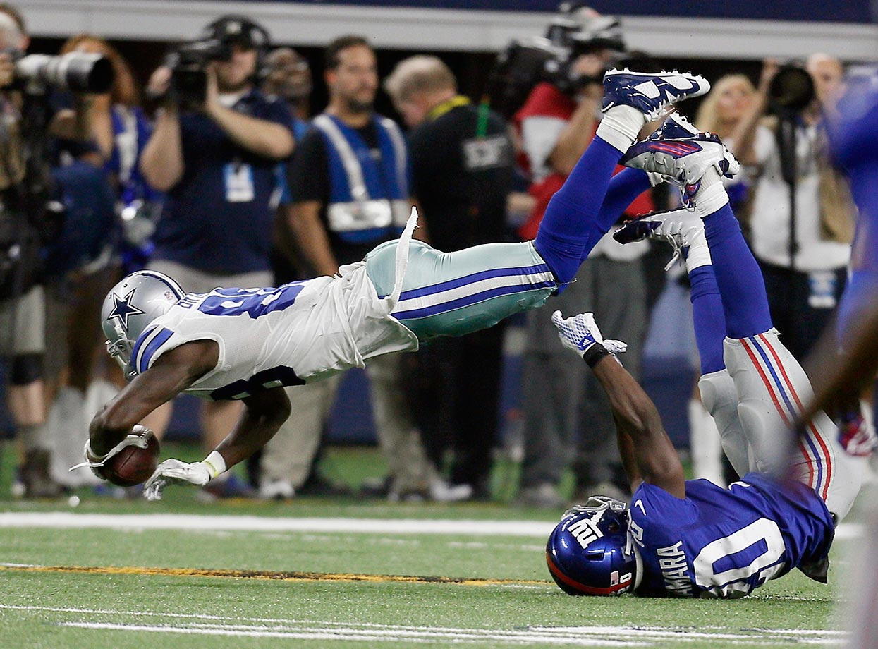 Dez Bryant of the Dallas Cowboy topples over Prince Amukamara of the Giants.