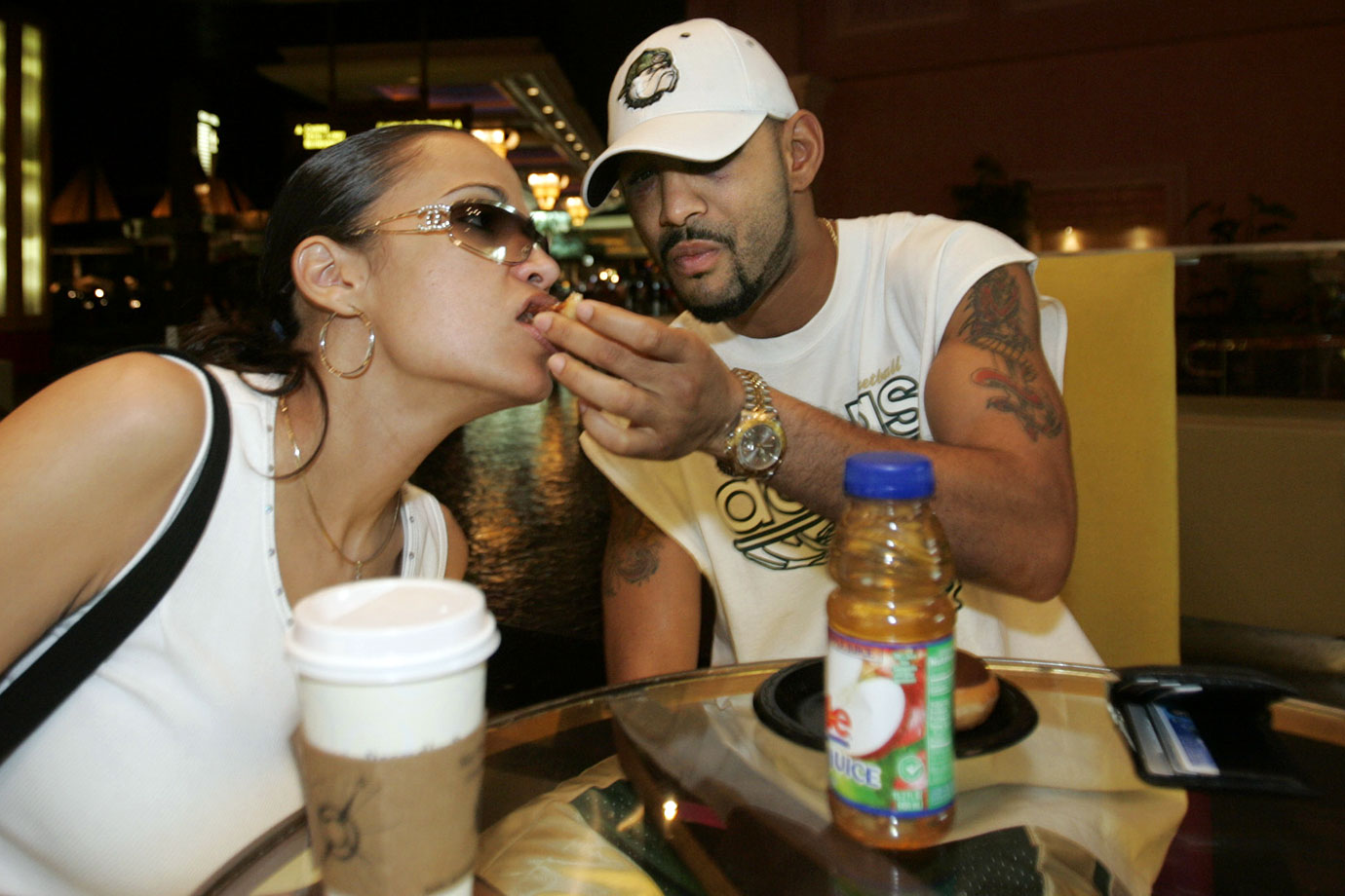 Undisputed lightweight champion Diego Corrales shares a doughnut with his wife Michelle at the Mandalay Bay Resort Hotel & Casino on May 10, 2005 in Las Vegas. Corrales, who got up from two knockdowns in the 10th round to beat Jose Luis Castillo three days earlier, was happy to be able to eat doughnuts again after weeks of strict fight training diet.