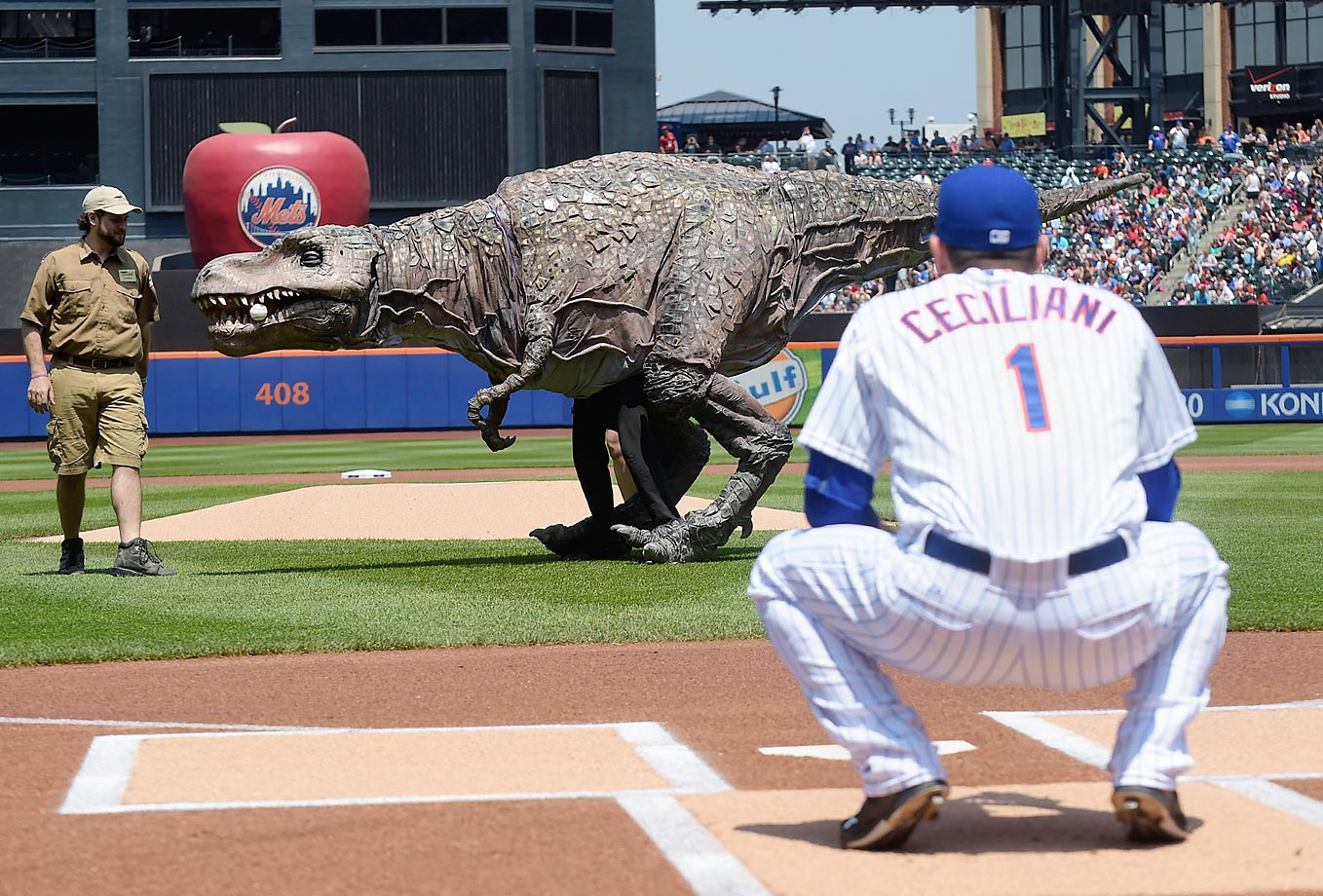 A Tyrannosaurus Rex from Field Station: Dinosaurs throws out the first pitch at the game against the Phillies at Citi Field,