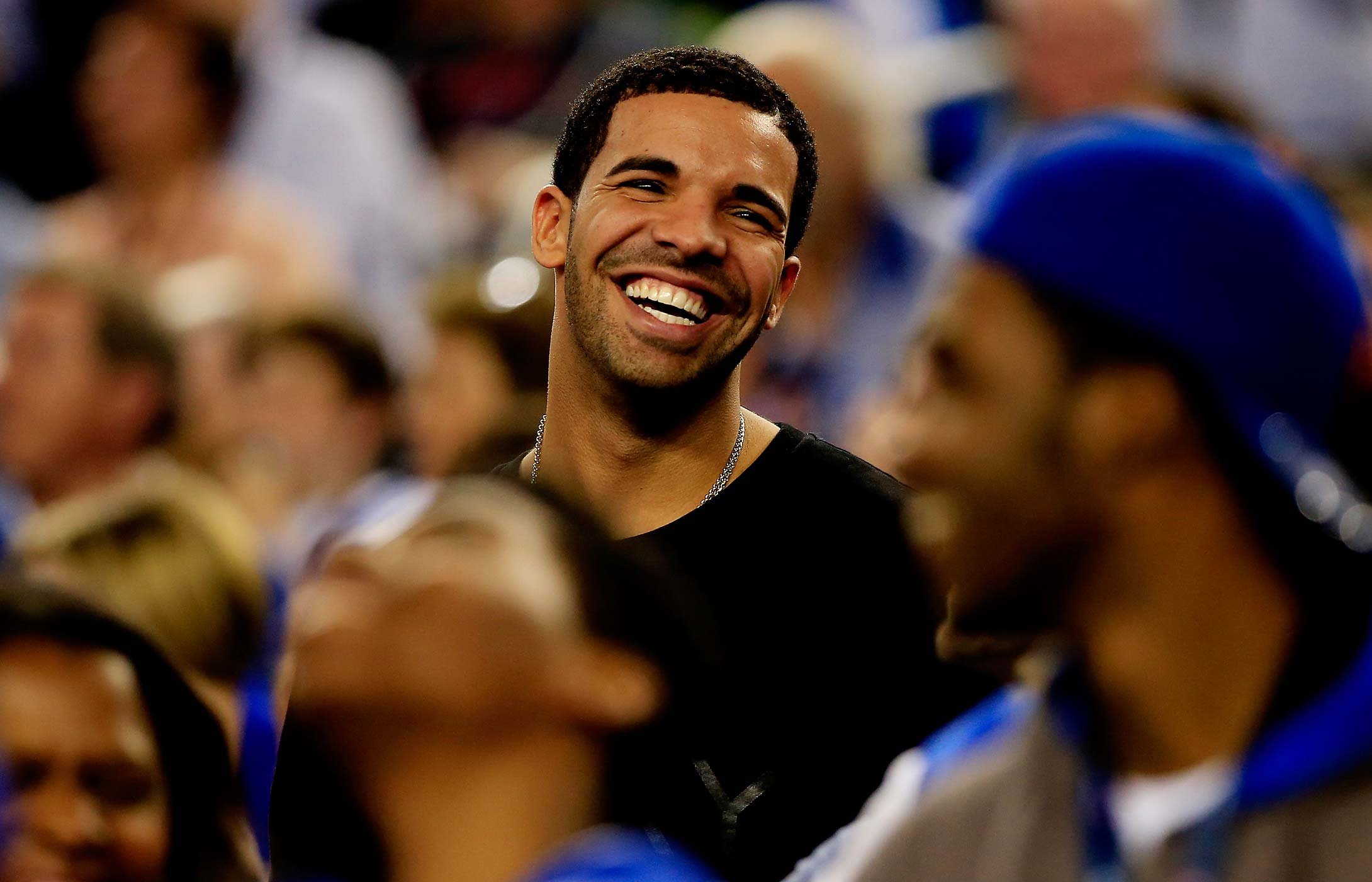Drake attends the 2014 Final Four semifinal between the Kentucky Wildcats and the Wisconsin Badgers at AT&T Stadium in Arlington, Texas.
