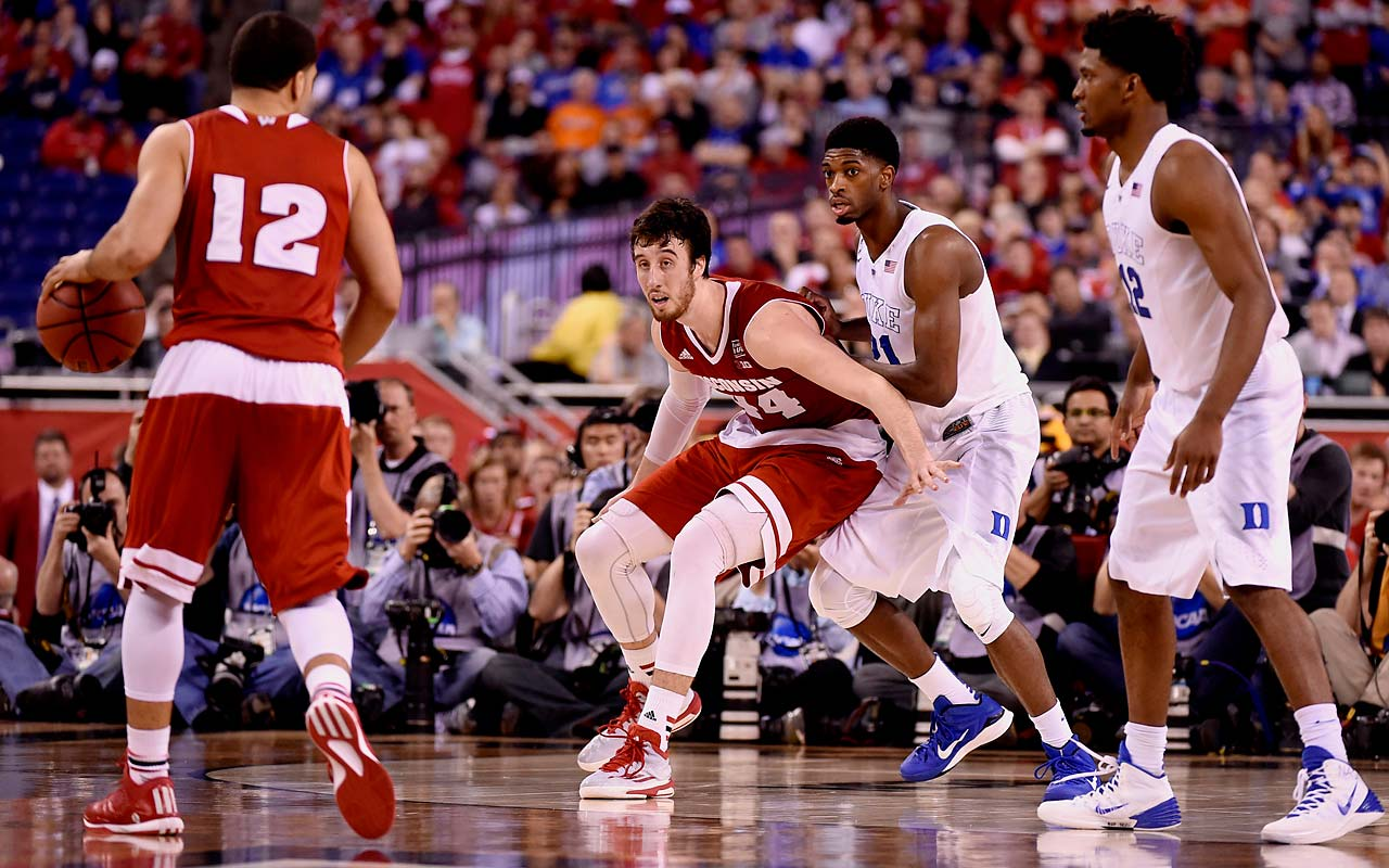 Wisconsin's Frank Kaminsky battles for position against Duke's Amile Jefferson. As Jahlil Okafor struggled through foul trouble, Jefferson provided key defense on Kaminsky throughout the night.