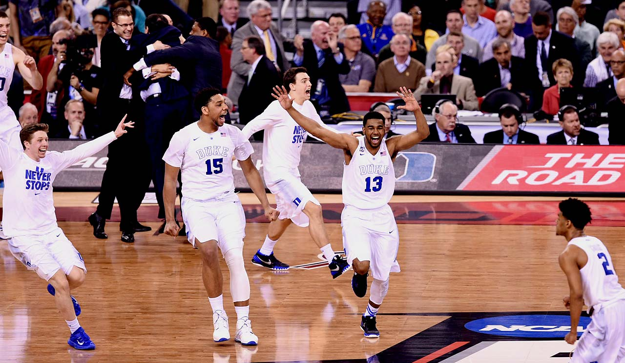 Jahlil Okafor (15), Matt Jones (13) and the rest of the Duke team celebrate the final buzzer that sealed the program's fifth championship.