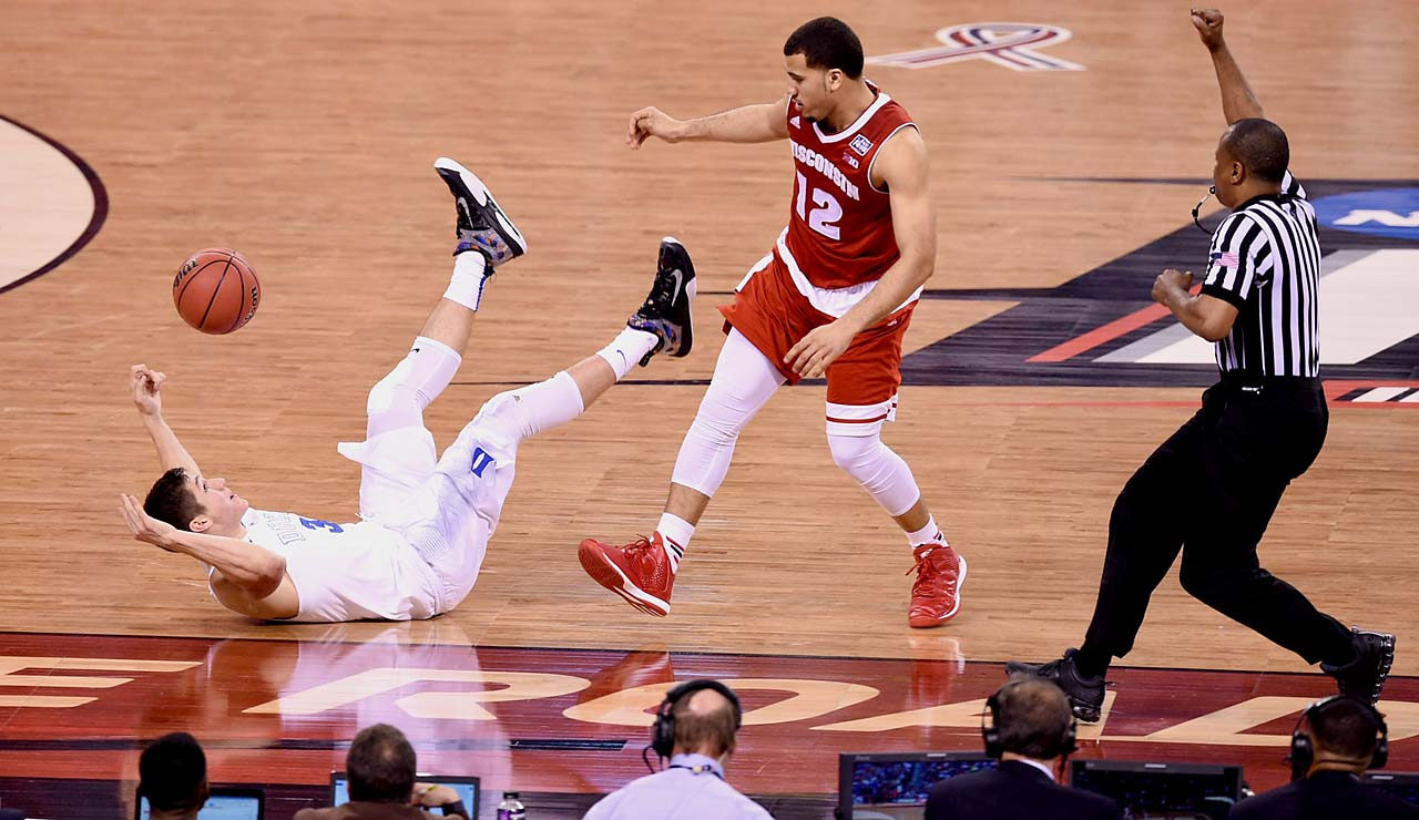 Grayson Allen takes a tumble after lunging for a loose ball against Traevon Jackson and Wisconsin.