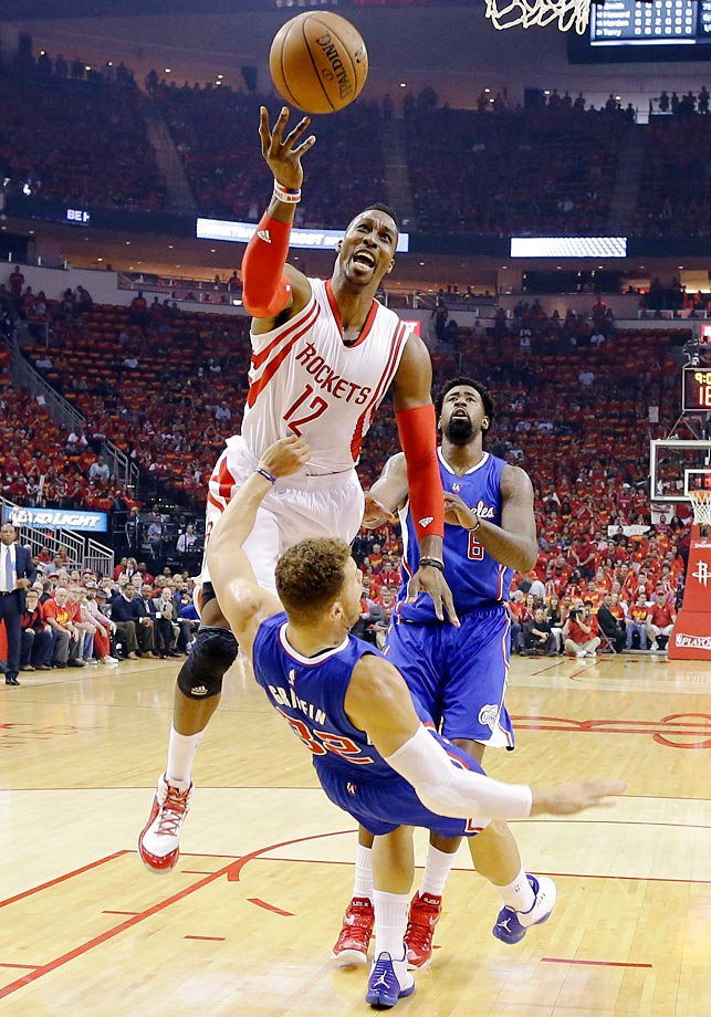 Dwight Howard of the Houston Rockets shoots over Blake Griffin of the Los Angeles Clippers in Game 7 of the NBA Western Conference semifinals.