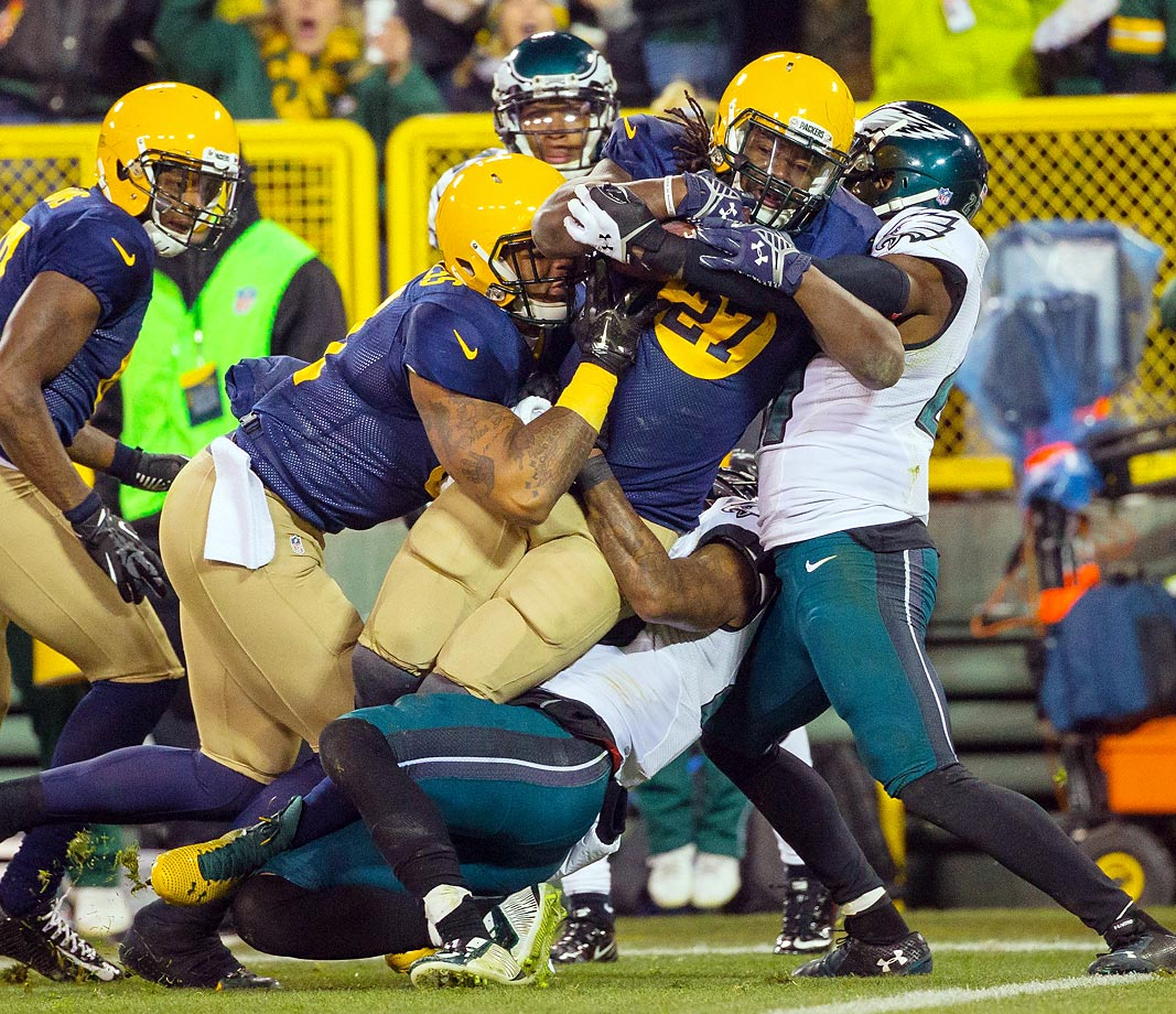 Green Bay Packers running back Eddie Lacy scores while Philadelphia Eagles defenders try to bring him down. The Packers won 53-20 at Lambeau Field.