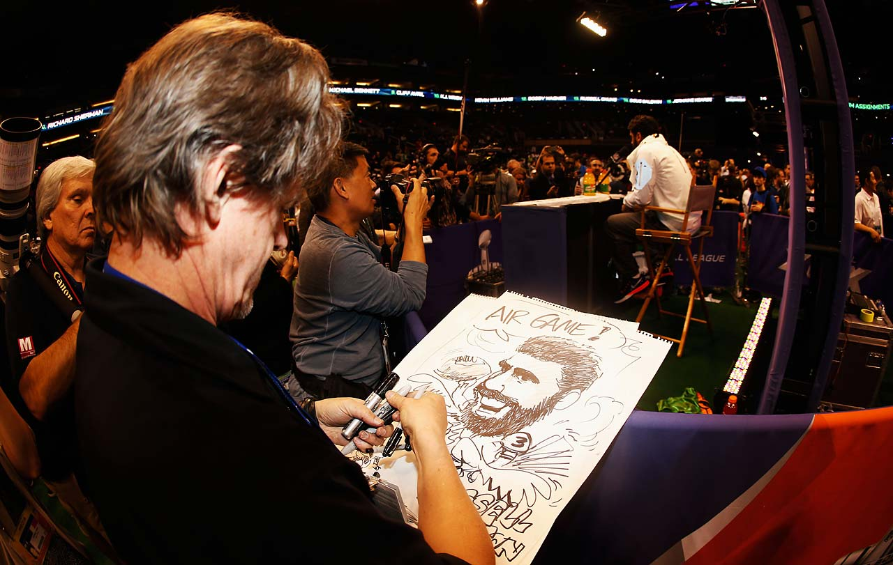 Editorial cartoonist Steve Benson of the Arizona Republic draws Russell Wilson at Super Bowl XLIX Media Day.