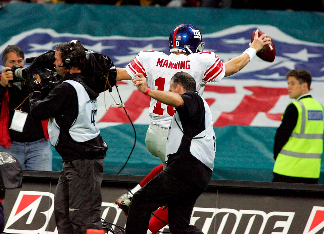 New York Giants quarterback Eli Manning had a brush with a cameraman after scoring a touchdown at Wembley Stadium in October 2007.