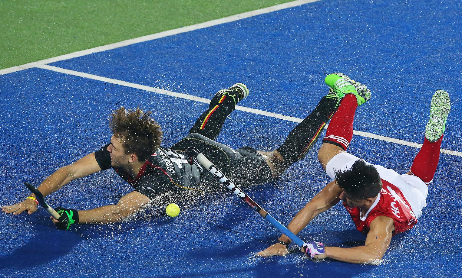 Emmanuel Stockbroekx of Belgian vies with Gabriel Ho-Garcia of Canada during the Hero Hockey League World Final in India.