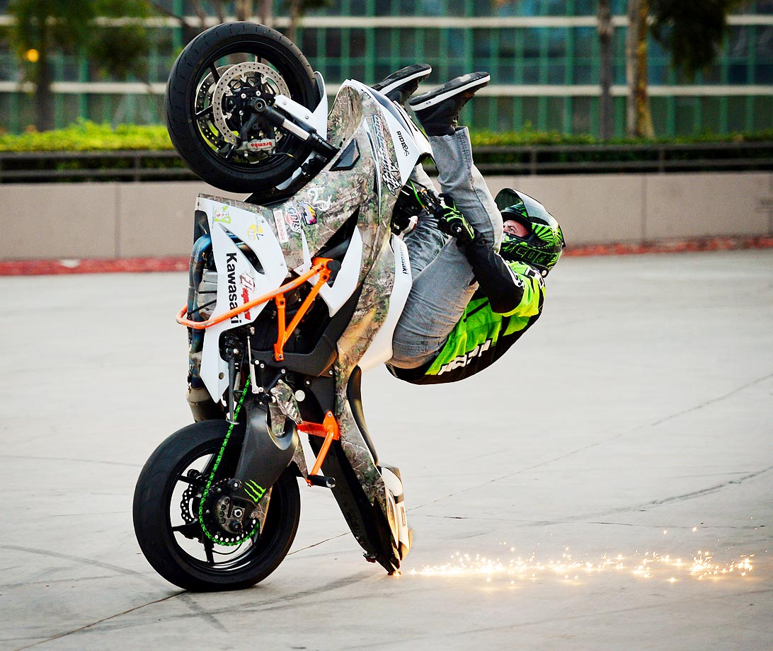 Eric Hoenshell performs a wheelie during the No Limits Stunt Show in Long Beach, Calif.