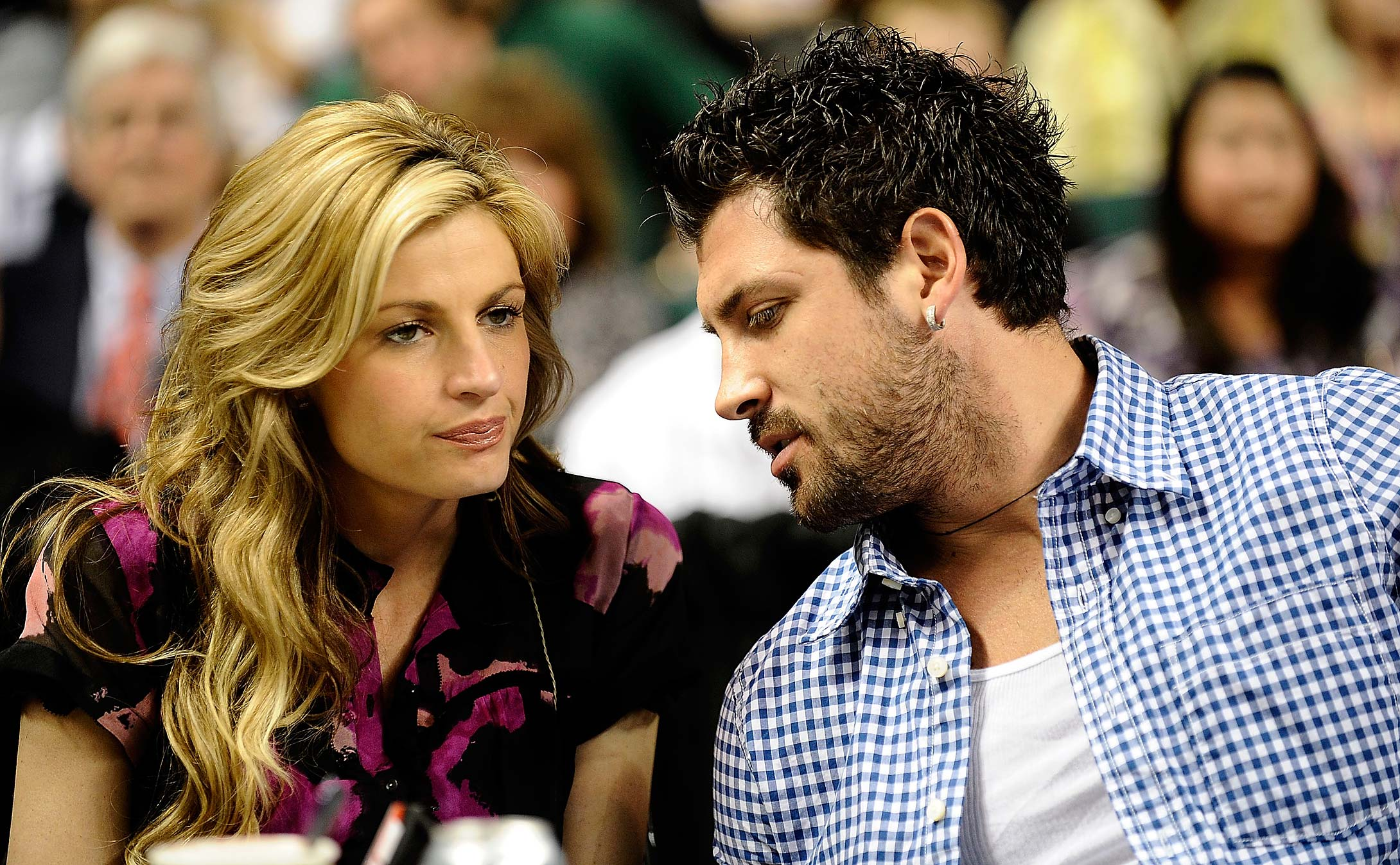 "Erin Andrews and her ""Dancing With The Stars"" partner Maksim Chmerkovskiy watch Duke- Miami at the 2010 ACC tournament in Greensboro."