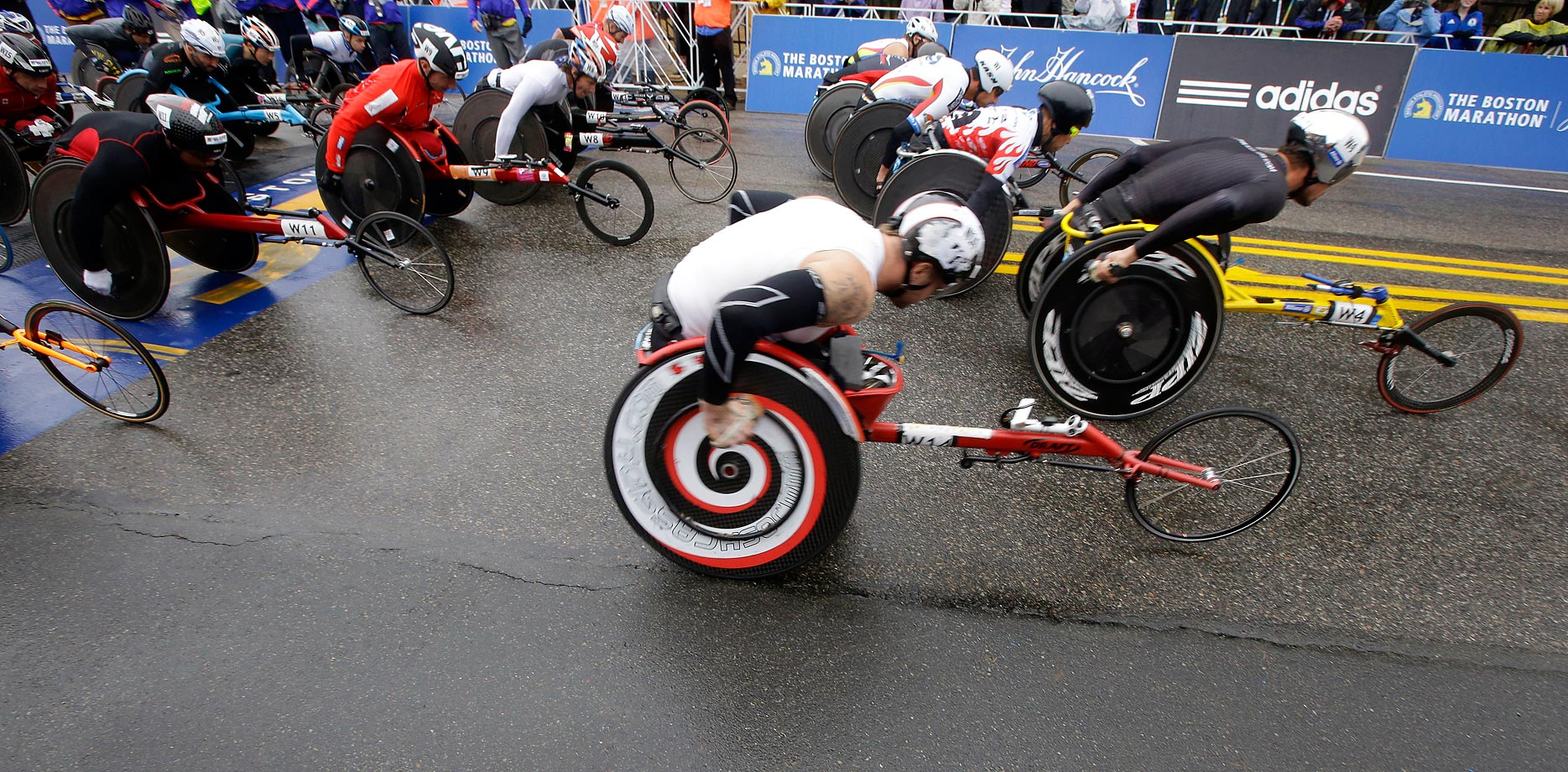 Ernst Van Dyk, foreground, of South Africa, leaves the start of the wheelchair division.