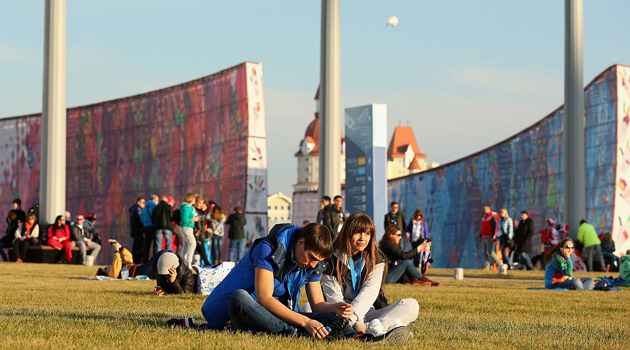 Spectators relax on the grass in Olympic Park on Valentine's Day.