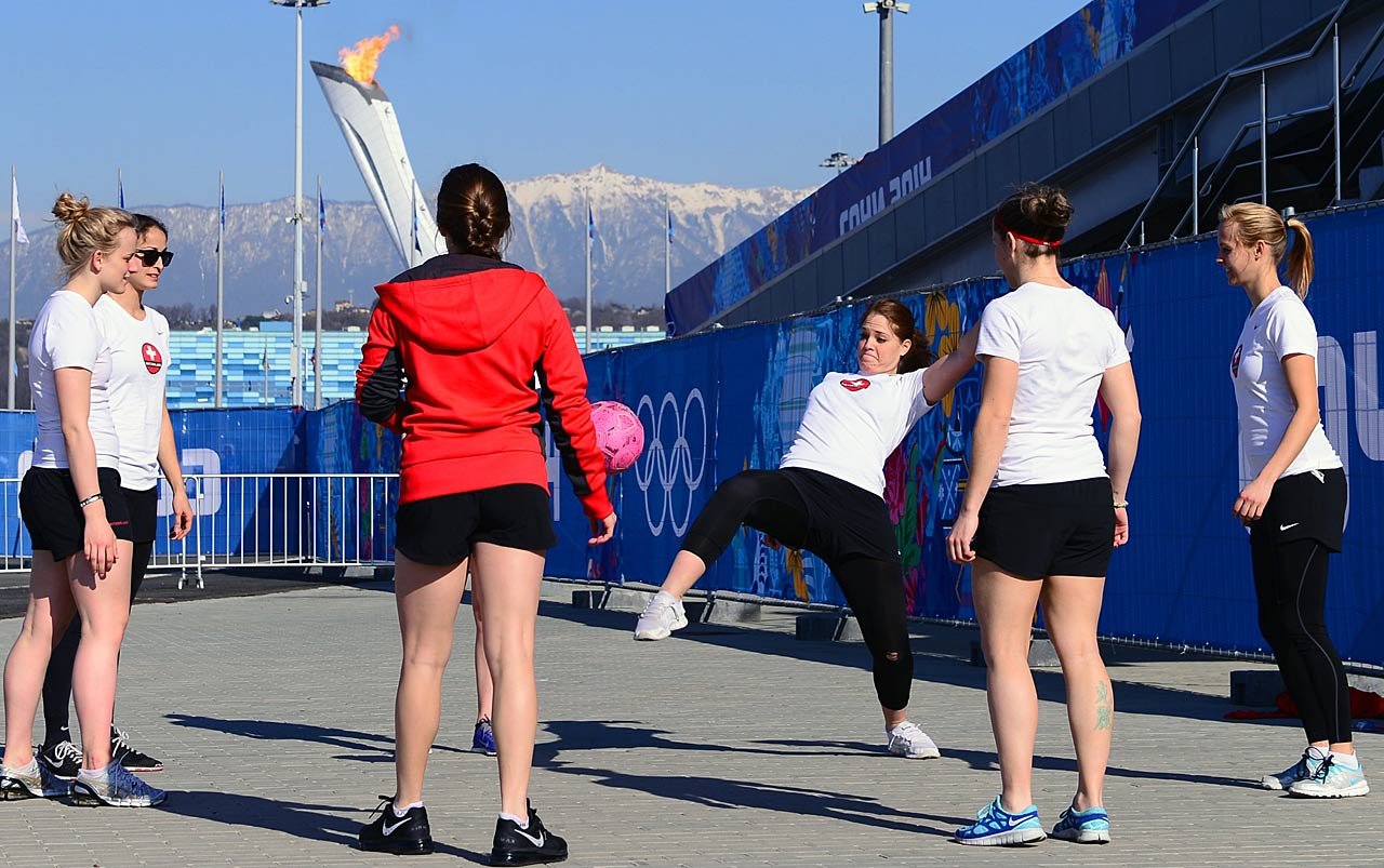 Switzerland women's hockey team warms up in Olympic Park before it's game against Russia.
