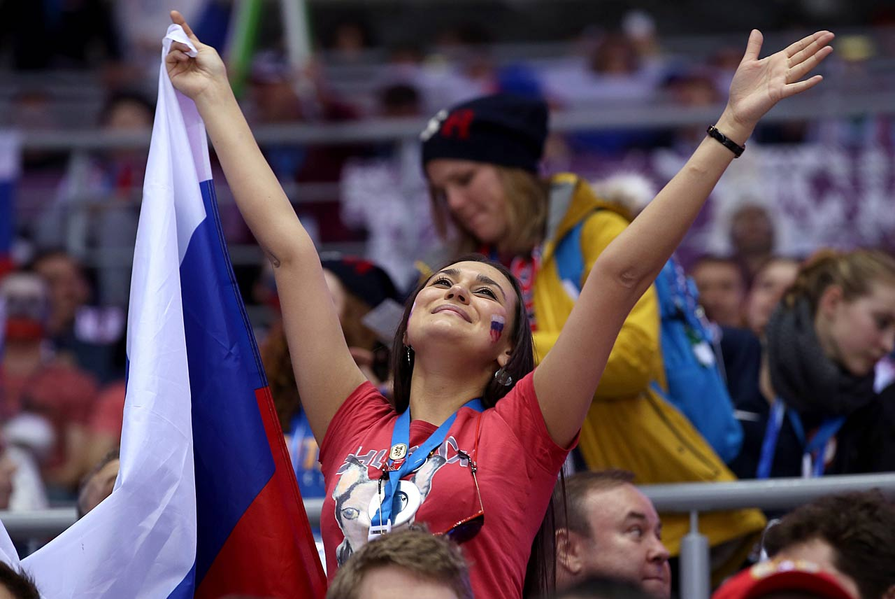 A Russian fan holds up a flag before the game between Russia and the United States.