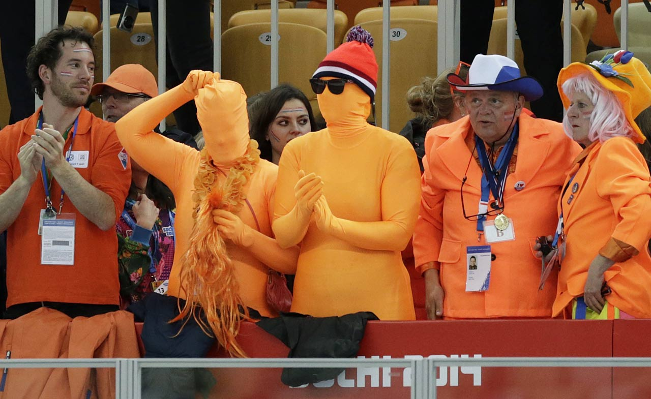 Dutch skating fans cheer for their country skater during the women's 1,000-meter speedskating race at the Adler Arena Skating Center.