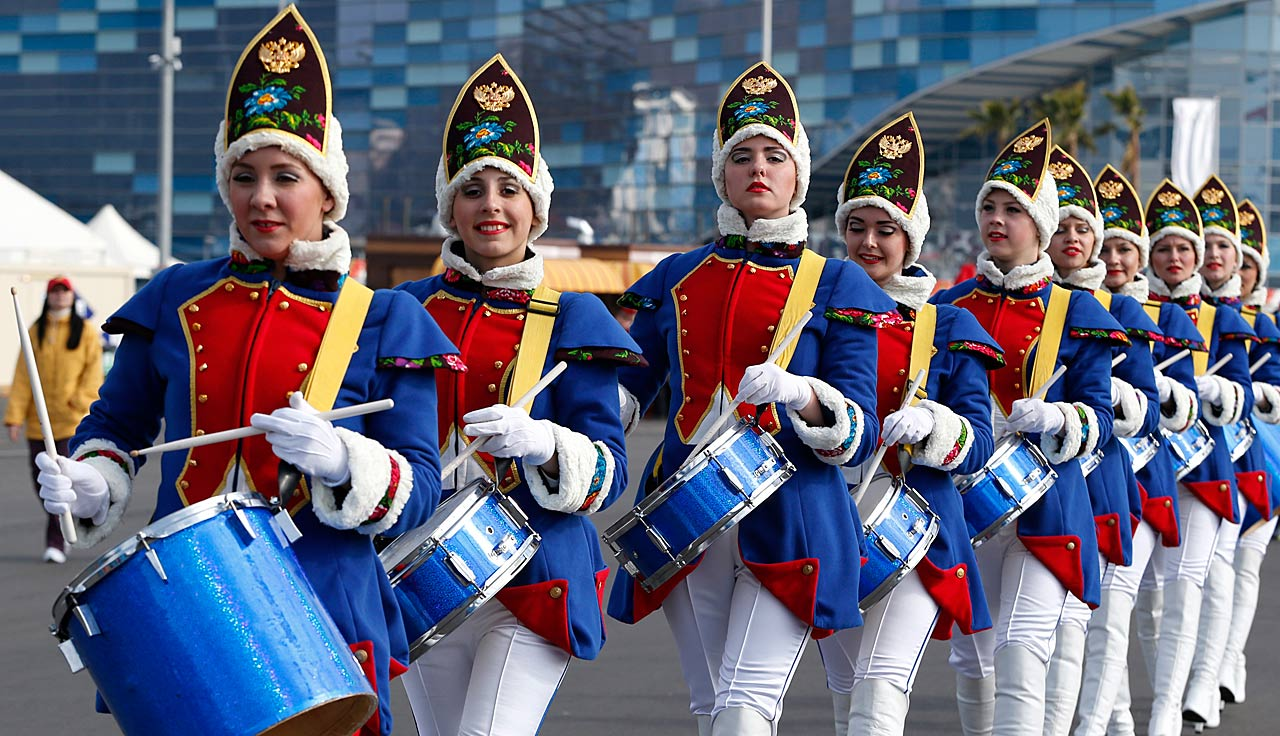Women drummers march near medals plaza in Olympic Park at the 2014 Winter Olympics.