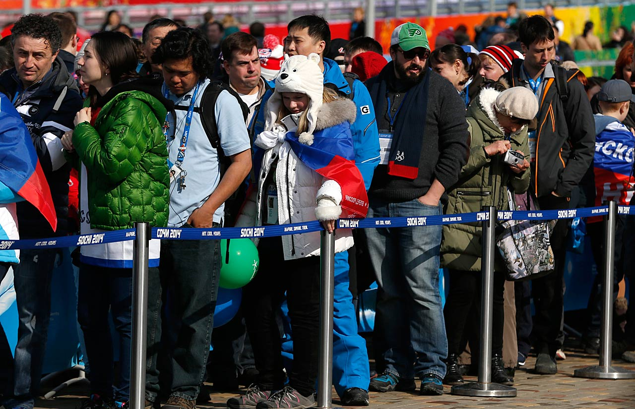 People wait in a long line outside a gift shop at Olympic Park.
