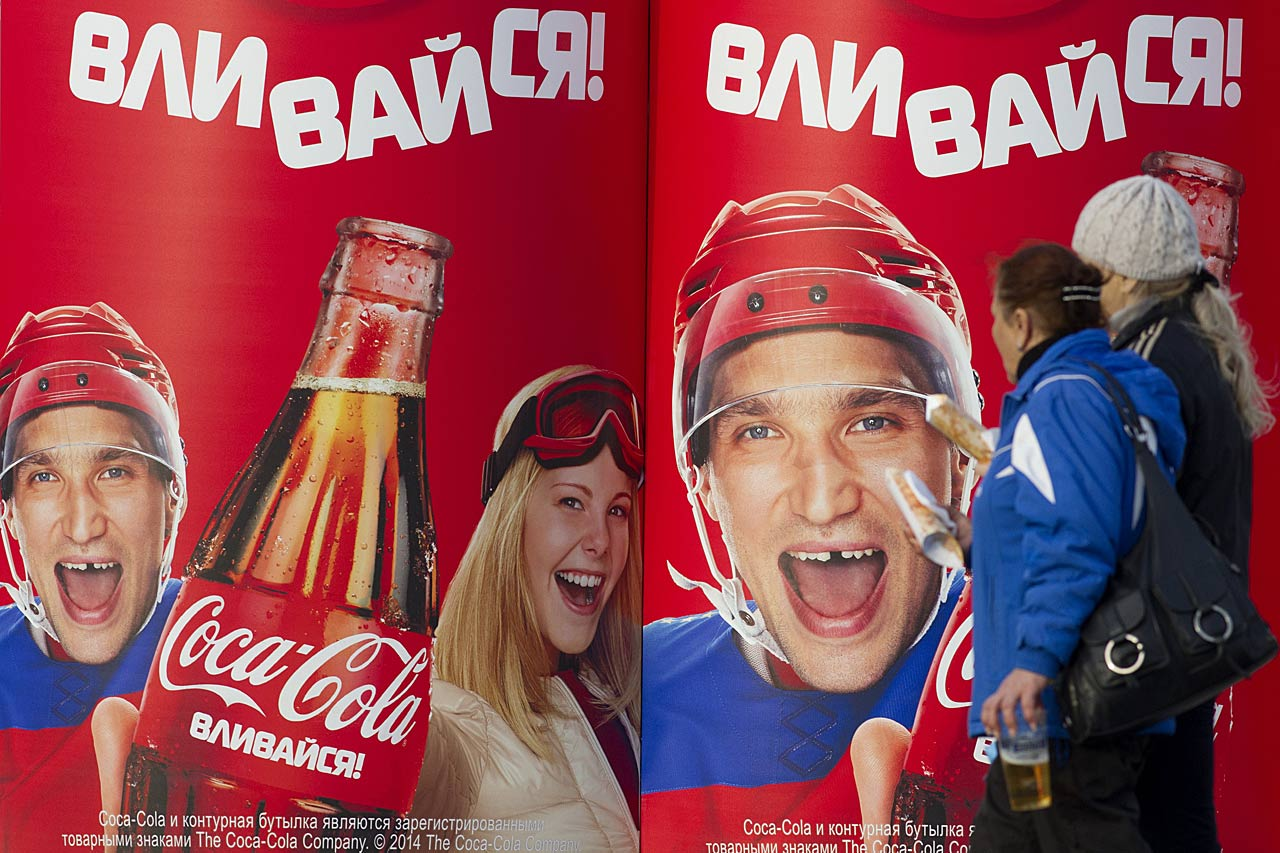 Fans stop to take in an Alex Ovechkin co-sponsored advertisement.