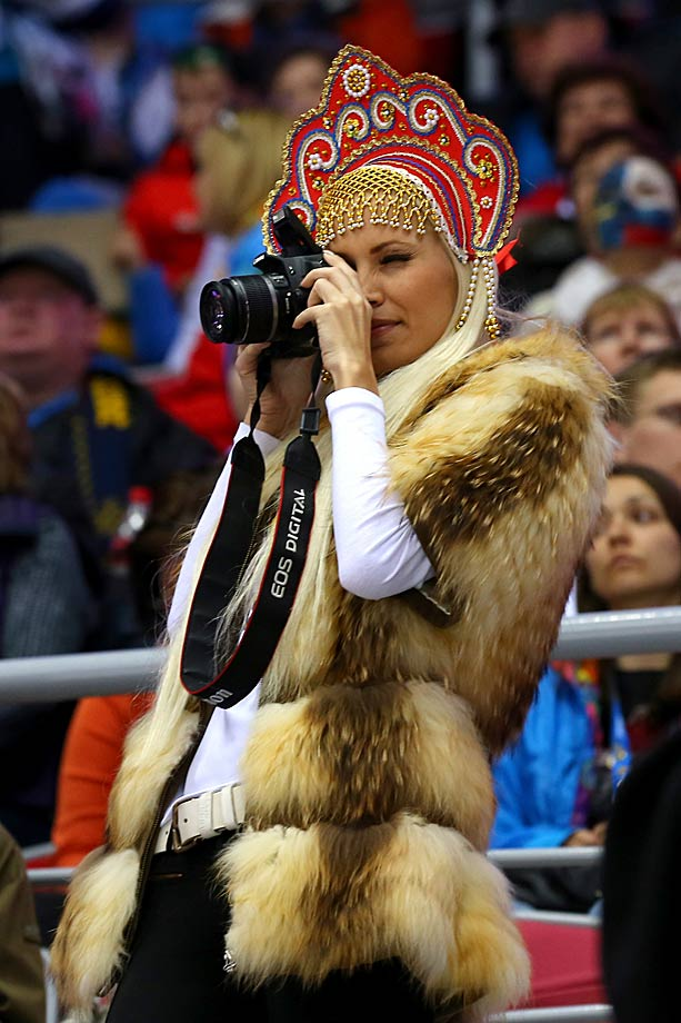 A fan takes a picture during Switzerland vs. Sweden in the bronze medal women's hockey game.
