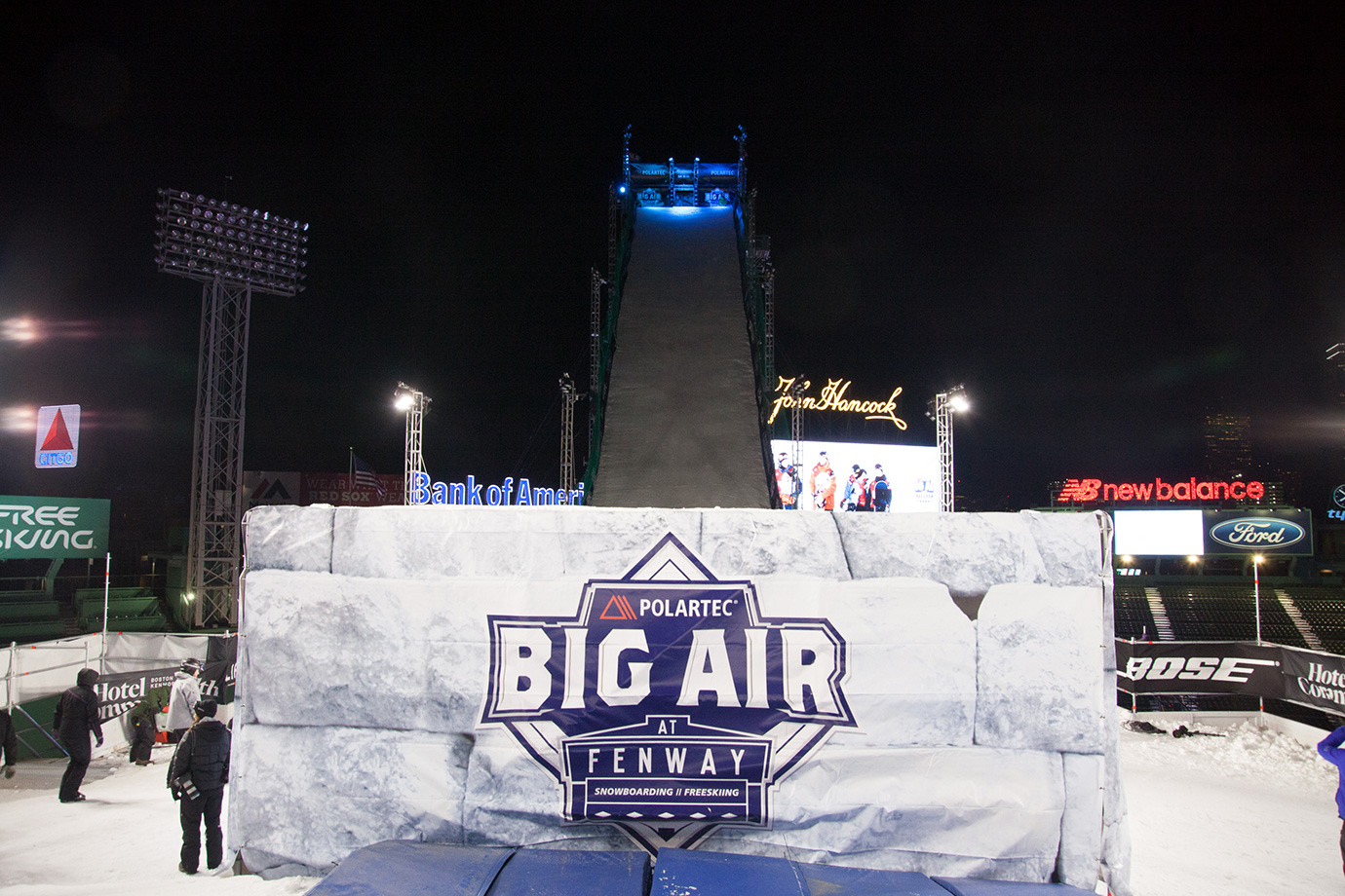 The Big Air ramp from the launch base as the snowboarders are introduced at the snowboarding competition.