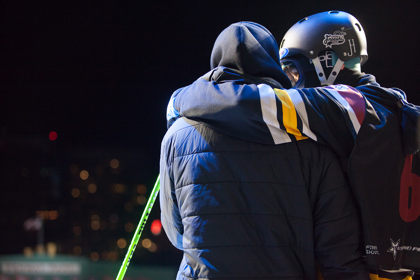 Boston favorite Jonas Hunziker embraces a member of his crew right before his final run.