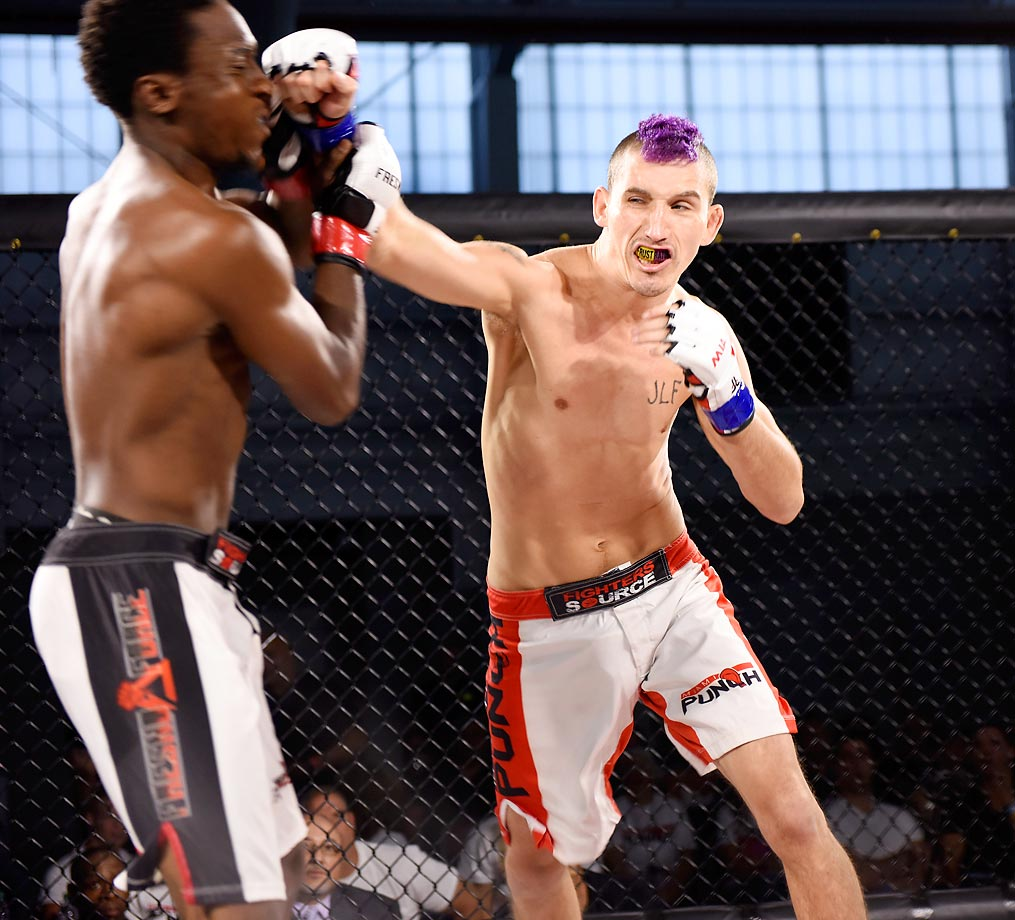 Chris Francis connects on a right cross to the face of Jesse Henderson during the Fighters Source U.S. Nationals during the MMA World Expo at Javits Center on July 26, 2014.